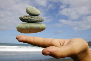 Align & Balance Stones balancing above hand dreamstime_m_284469
