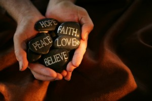 Core Beliefs rock hands
